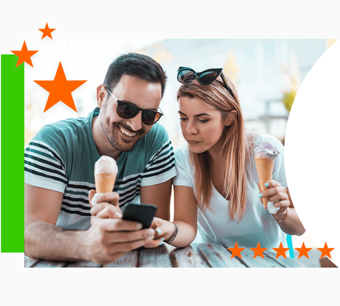 two people eating ice cream and leaving a review on phone